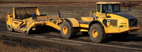 K-Tec earthmover and Volvo tractor from Alta Equipment.